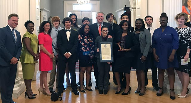 Heritage students and administrators pose with Governor McAuliffe after the ceremony at the Governor's Mansion in Richmond.